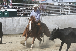 Buck McEwen riding Freckled Merada